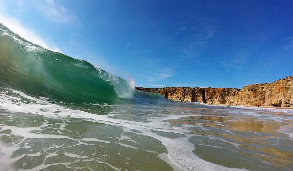 Perfect surf waves at Praia do Beliche, Sagres
